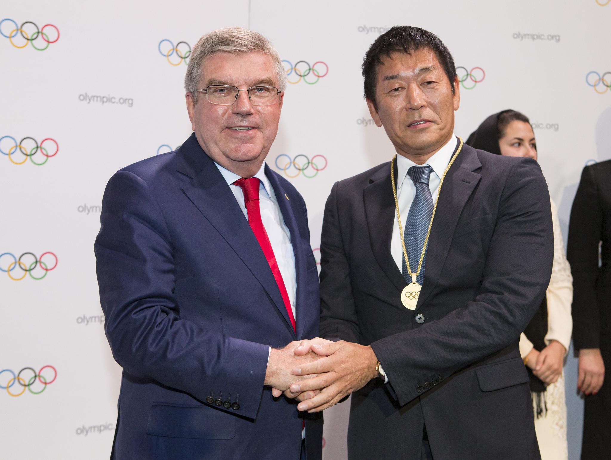 IOC president Thomas Bach with FIG president Morinari Watanabe